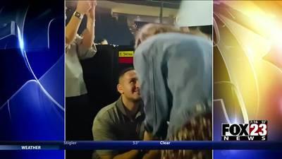 Tulsa police officer surprises girlfriend with proposal at Blake Shelton concert