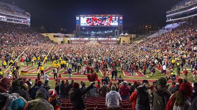 Arkansas fined after fans rush the field following win vs Texas