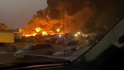 Bristow tire plant fire continues to smolder, DEQ cites violations